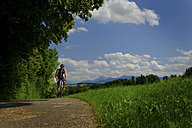 Germany, Upper Bavaria, Chiemgau, bicycle tour, mature man on bike - HAMF000212