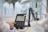 Scientist in lab checking measurements - ZEF009926