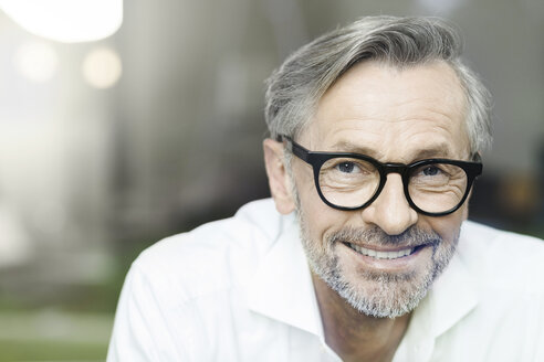 Portrait of smiling man with grey hair and beard wearing spectacles - SBOF000206