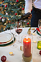 Man serving wine at Christmas dinner - ABZF001050