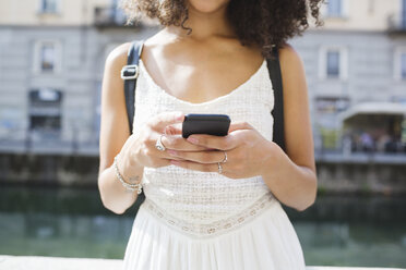 Young woman text messaging, partial view - MRAF000126