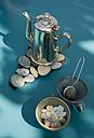 Matal tea pot on self made pebble table mat - GISF000244