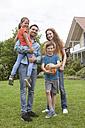 Portrait of smiling family standing in garden - RBF005134