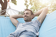 Smiling man relaxing in hammock - RBF005143