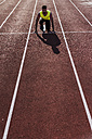 Runner on tartan track in starting position - UUF008293
