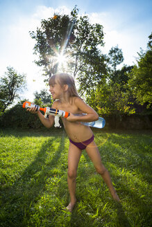 Little girl splashing water with water gun - LVF005233