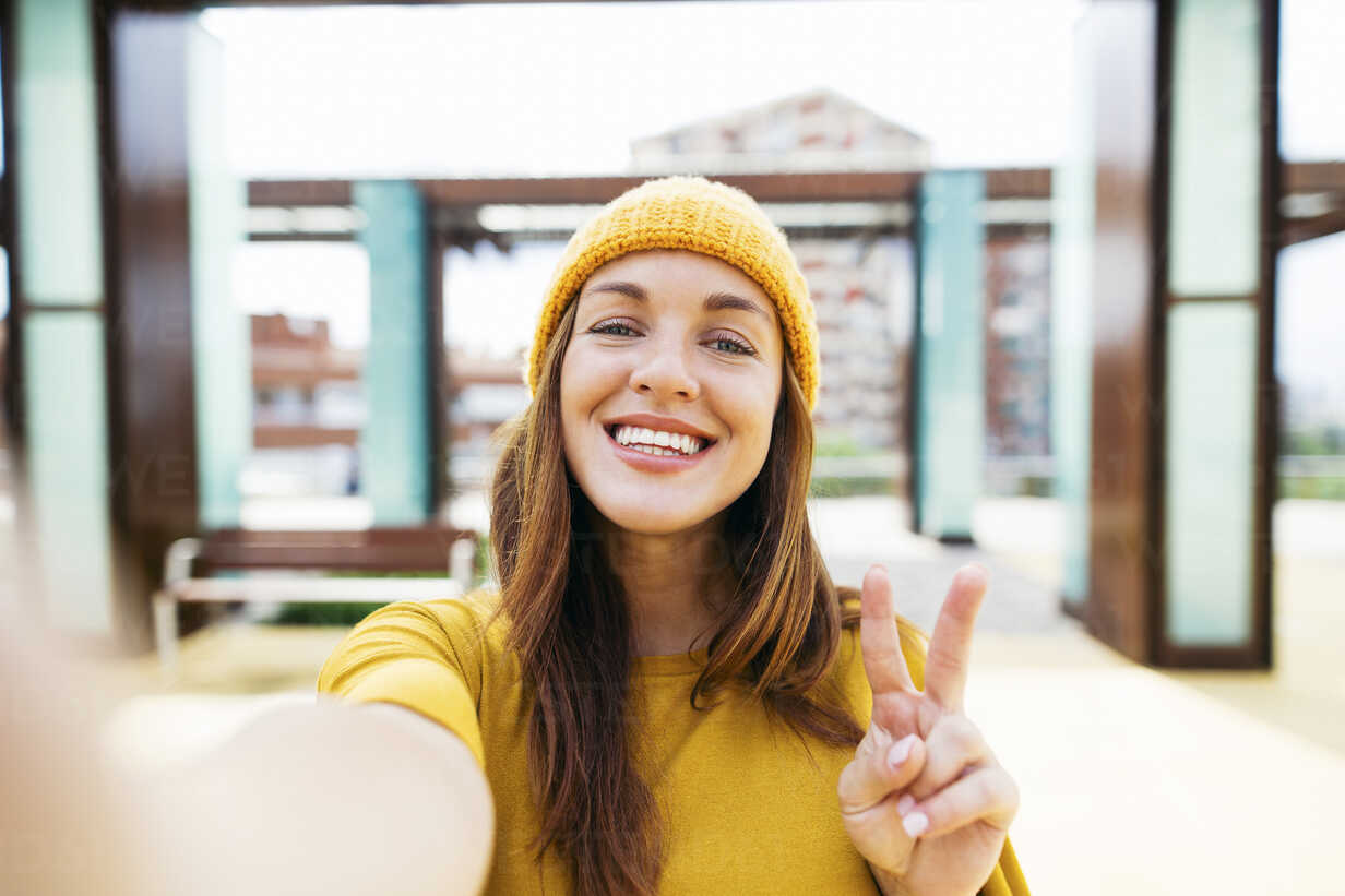 Portrait of smiling young woman wearing yellow clothes taking selfie - EBSF001702 - Bonninstudio/Westend61