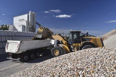 Wheel loader loading gravel on truck - LYF000578