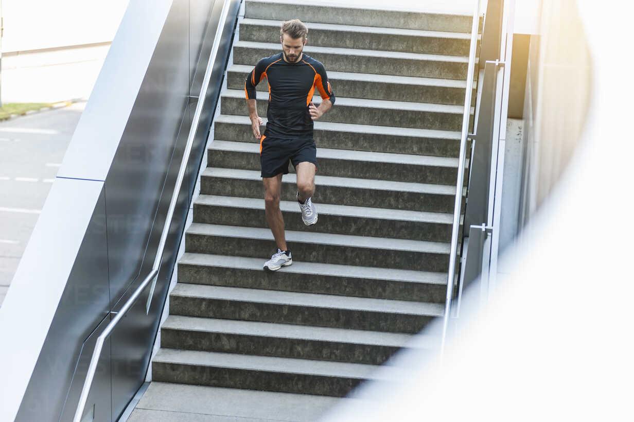 Man running down stairs - DIGF001059 - Daniel Ingold/Westend61