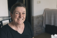 Portrait of happy woman at home - SKCF000190