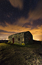 Spain, Galicia, Little abandoned building at night in Garita Herbeira - RAEF001447