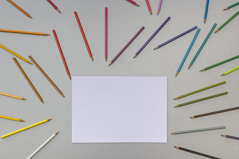 Coloured pencils and a blank sheet of paper - MELF000142