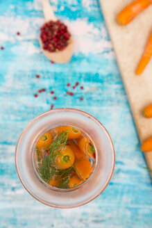 Glass of fermenting carrots with red peppercorns and dill - LVF005241