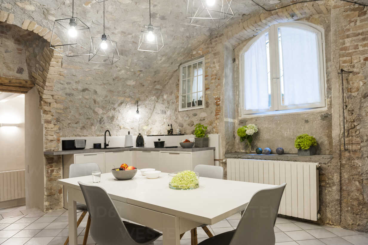 Interior Of Modern Kitchen In Old Stone House Stockphoto