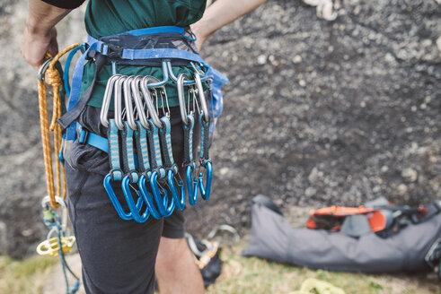 Close-up of climber with climbing equipment - RAEF001460