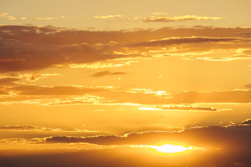 Sunset, orange sky with clouds, against the sun - KRPF001813