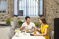 Couple in kitchen eating pasta - DIGF001213
