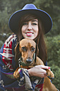 Portrait of happy woman with her dachshund - RTBF000327