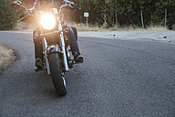 Man riding motorbike on country road - ABZF001156