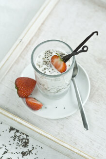 Chia pudding with fresh strawberries and vanilla bean in glass - ASF006018