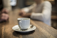 Coffee cup on counter - ZEF010048
