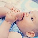Baby putting foot into his mouth - MFF003158