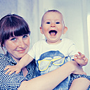 Happy mother holding her baby son - MFF003161