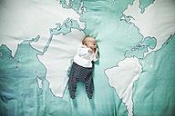 Newborn baby sleeping on blanket with world map - MFF003200