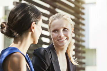 Two businesswomen talking outside - MFF003347
