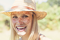Portrait of laughing young woman with straw hat - MFF003356