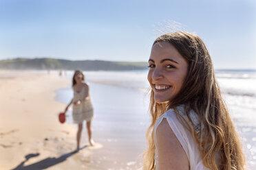 Portrait of happy teenage girl on the beach - MGOF002382