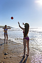 Two friends playing with ball on the beach - MGOF002412