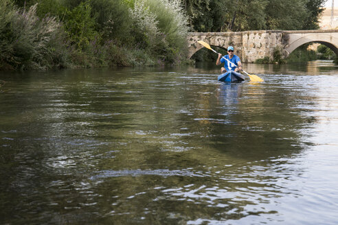 Spain, Segovia, Man in a canoe - ABZF001185