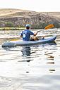Spain, Segovia, Man in a canoe in Las Hoces del Rio Duraton - ABZF001188