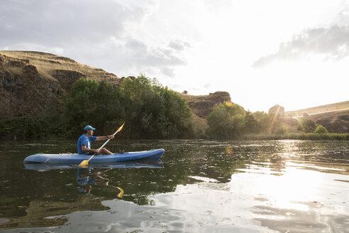 Spain, Segovia, Man in a canoe in Las Hoces del Rio Duraton - ABZF001191