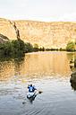 Spain, Segovia, Man in a canoe in Las Hoces del Rio Duraton - ABZF001194