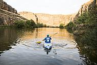 Spain, Segovia, Man in a canoe in Las Hoces del Rio Duraton - ABZF001197