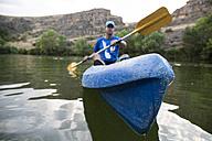 Spain, Segovia, Man in a canoe in Las Hoces del Rio Duraton - ABZF001203
