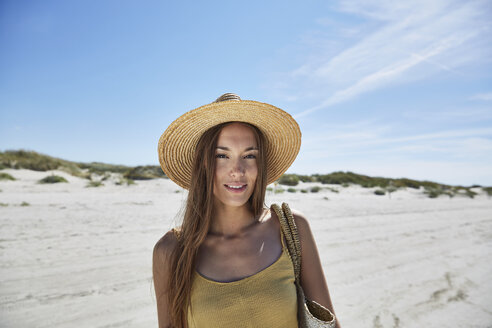Portrait of young woman on the beach - SRYF000009