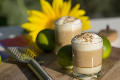 Layered coffee, condensed milk, liqueur, espresso and milk froth - YFF000572