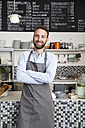 Portrait of smiling barista in a cafe - WESTF021647
