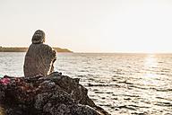 France, Crozon peninsula, woman at beach - UUF008334