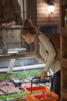 Woman shopping in butchery - ZEF010285