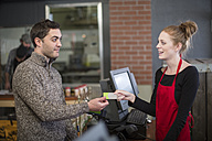 Customer paying in shop - ZEF010309