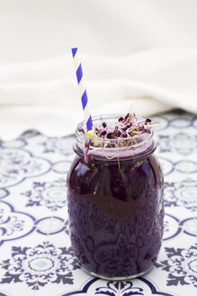 Glass of red cabbage smoothie with beetroot sprouts - LVF005275