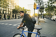 Teenager with a bike in the city - EBSF001724