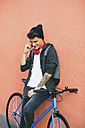 Teenager with a fixie bike, using smartphone - EBSF001760