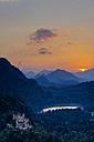 Germany, Bavaria, Allgaeu, Hohenschwangau Castle and Lake Alpsee at sunset - WG00957