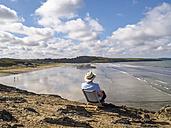France, Brittany, Sainte-Anne-la-Palud, senior man at the beach Treguer plage - LAF01722