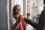 Creative professionals using sticky notes - ZEF10368